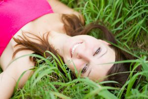 Beautiful Girl Realxing On the Grass