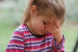 Girl Experiences Headache